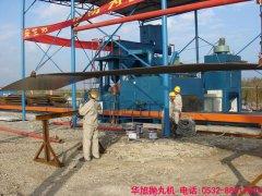 工程师正在对通过式抛丸机检修